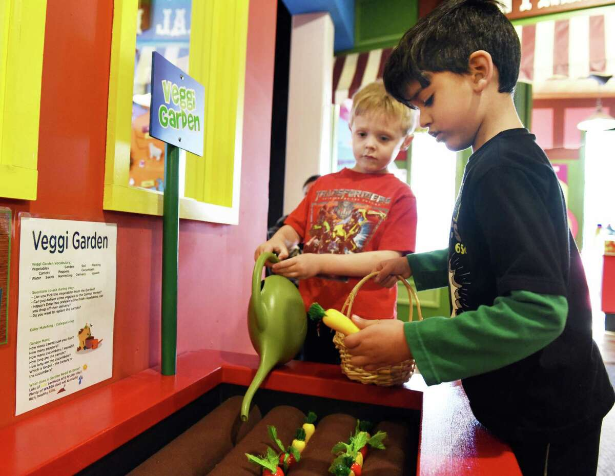 Five-year-olds Chase Pellett, left, and Lucas Rivera, both of Ballston Lake, play at the Children's Museum of Saratoga's new Veggie Garden play area Thursday Jan. 5, 2017 in Saratoga Springs, NY. (John Carl D'Annibale / Times Union)