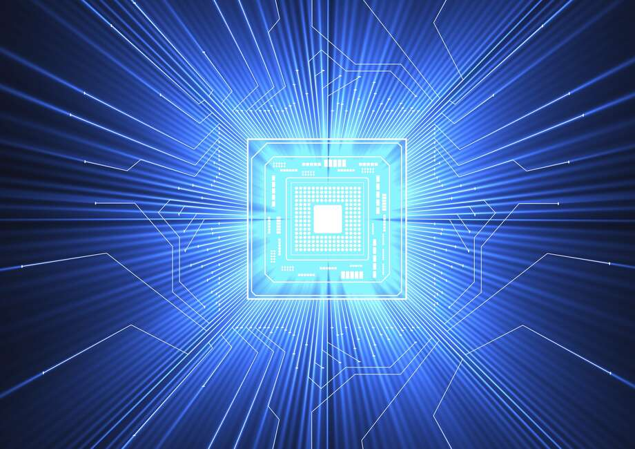 Quantum computer. Conceptual computer artwork of electronic circuitry with blue light passing through it, representing how data may be controlled and stored in a quantum computer. Photo: ALFRED PASIEKA, SCIENCE PHOTO LIBRARY, Getty Images
