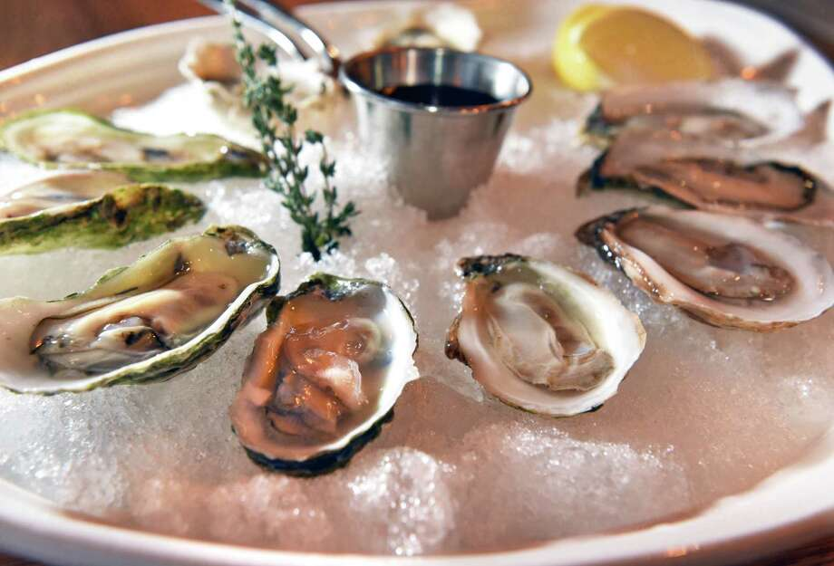 An oyster sampler served with a lemon wedge and house Mignonette sauce at the Plumb Oyster Bar Thursday Jan. 5, 2017 in Troy, NY.  (John Carl D'Annibale / Times Union) Photo: John Carl D'Annibale / 20039319A