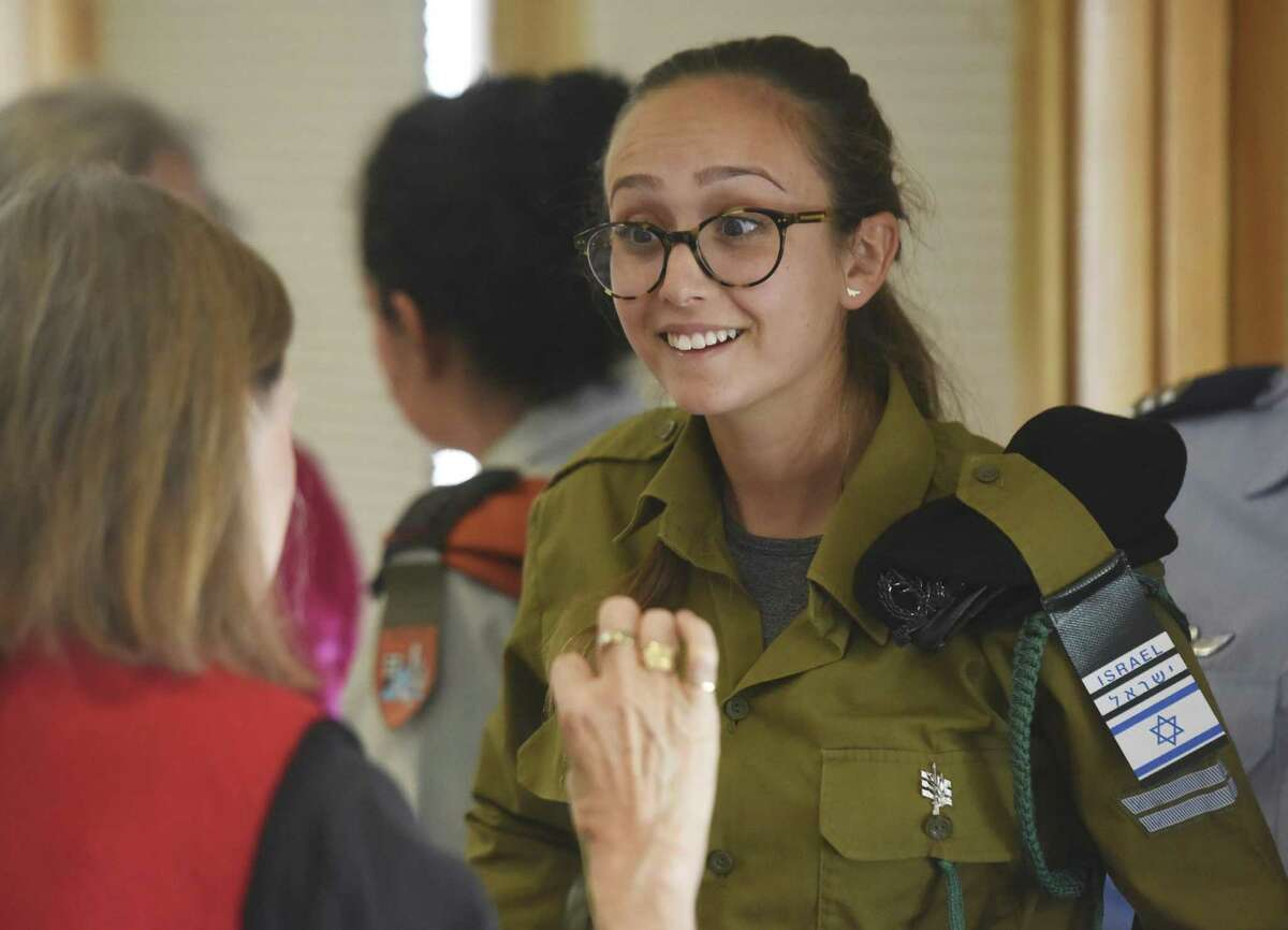 Israel Defense Forces soldier, Captain Zohar, 19, chats with members of the audience after speaking at Temple Sholom in Greenwich, Conn. Tuesday, Jan. 10, 2017. Four active duty IDF soldiers spoke about their roles in the service, specific missions they took part in, and addressed the political climate and current events in Israel.