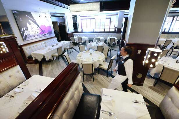 Updated interior at Angelo's 677 Prime Monday morning, Sept. 21, 2015, on Broadway in Albany, N.Y.  (Will Waldron/Times Union)