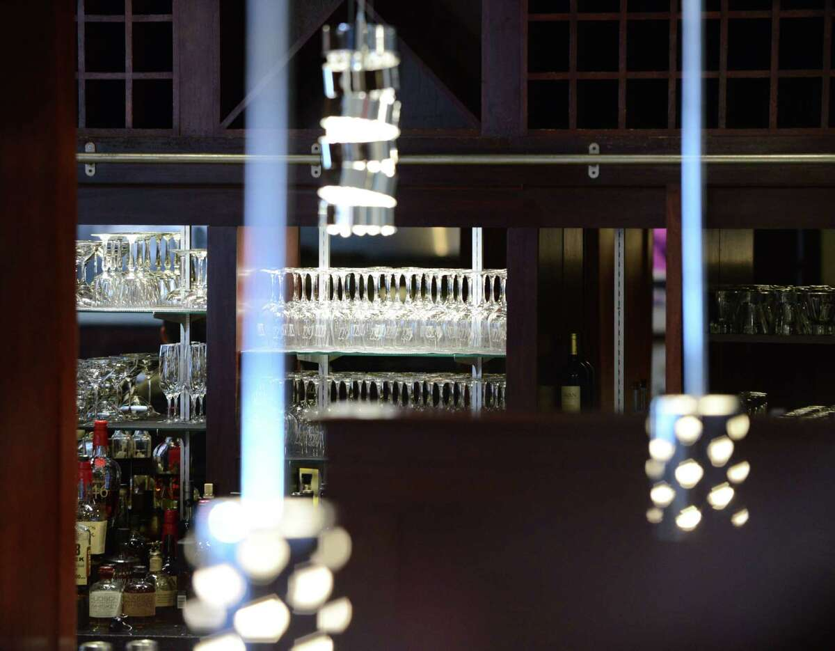 New light fixtures are part of updated interior at Angelo?'s 677 Prime Monday morning, Sept. 21, 2015, on Broadway in Albany, N.Y. (Will Waldron/Times Union)