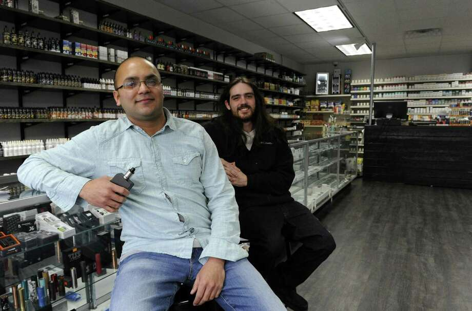 Owner Zach Zamir and manager Manny Peters are photographed on Jan. 6, 2017 at Stamford Vapor and Smoke. Photo: Matthew Brown / Hearst Connecticut Media / Stamford Advocate