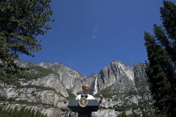 FILE - In this Saturday, June 18, 2016, file photo, President Barack Obama speaks by the Sentinel Bridge in the Yosemite Valley in front of Yosemite Falls, the highest waterfall in the park, at Yosemite National Park, Calif. In a new project with National Geographic, Obama becomes the first sitting U.S. president to project himself into virtual reality, in this case, a 360-degree representation of Yosemite National Park. The 11-minute VR video, narrated by Obama, is one part paean to the wonders of America�s national parks and one part warning of the threat posed by climate change. (AP Photo/Jacquelyn Martin, File)