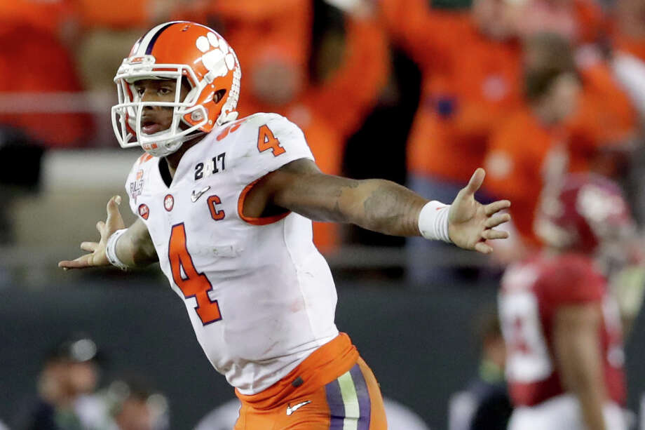 TAMPA, FL - JANUARY 09:  Quarterback Deshaun Watson #4 of the Clemson Tigers celebrates after throwing a 2-yard game-winning touchdown pass during the fourth quarter against the Alabama Crimson Tide to win the 2017 College Football Playoff National Championship Game 35-31 at Raymond James Stadium on January 9, 2017 in Tampa, Florida.  (Photo by Streeter Lecka/Getty Images) Photo: Streeter Lecka, Staff / 2017 Getty Images