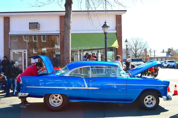 Lorenzo Diurno of Wilton grabs something out of the trunk of his 1955 Bel Air at the Caffeine & Carburetors on Elm Street in New Canaan, Conn. last month. Caffeine & Carburetors will host its next show on May 22 at Waveny Park in New Canaan.