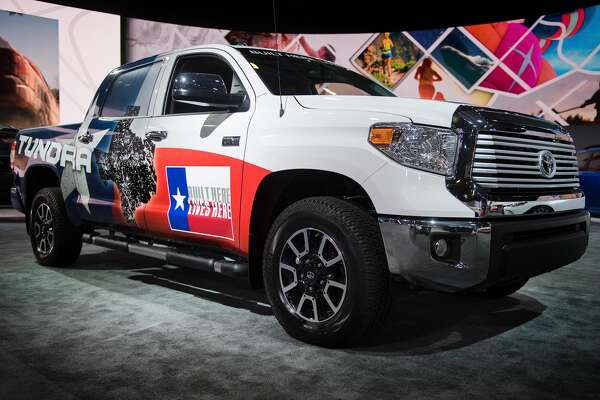 """The Toyota Tundra, with lettering on the tailgate stating """"Built Here Lives Here"""",  is shown during the 2017 North American International Auto Show in Detroit, Michigan, January 10, 2017. / AFP / JIM WATSON        (Photo credit should read JIM WATSON/AFP/Getty Images)"""