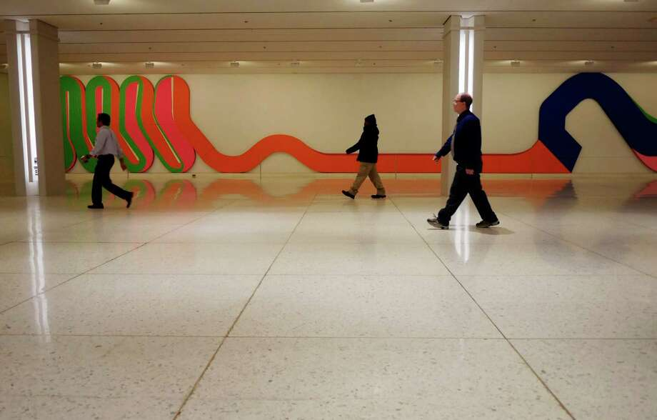 People make their way through the concourse of the Empire State Plaza on Tuesday, Dec. 27, 2016, in Albany, N.Y.   (Paul Buckowski / Times Union) Photo: PAUL BUCKOWSKI / 20039236A