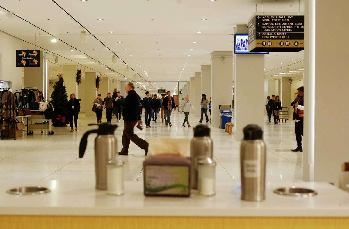 People make their way through the concourse of the Empire State Plaza on Tuesday, Dec. 27, 2016, in Albany, N.Y. (Paul Buckowski / Times Union)