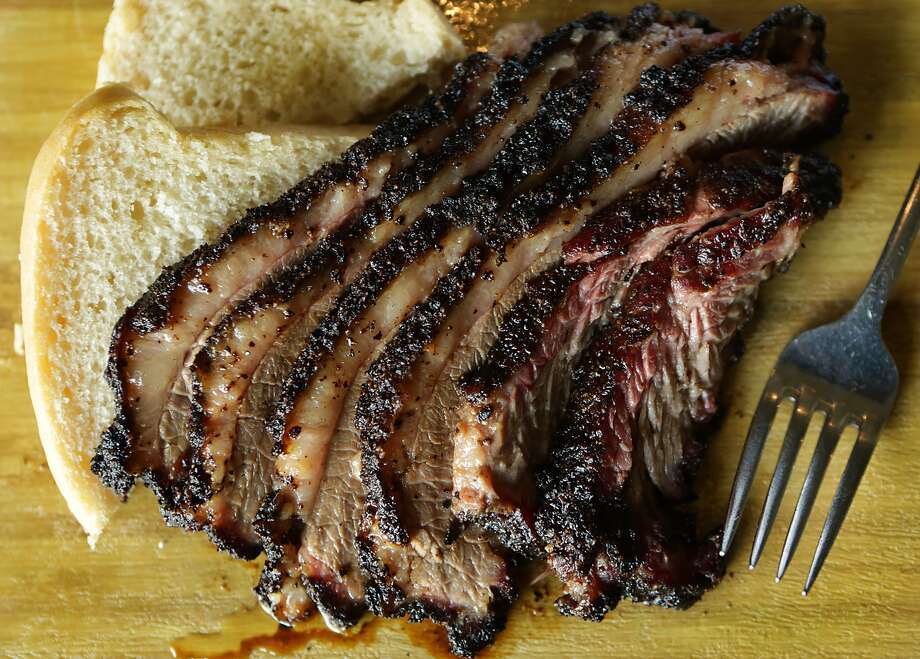 Brisket with housemade bread at Smoke: The Restaurant