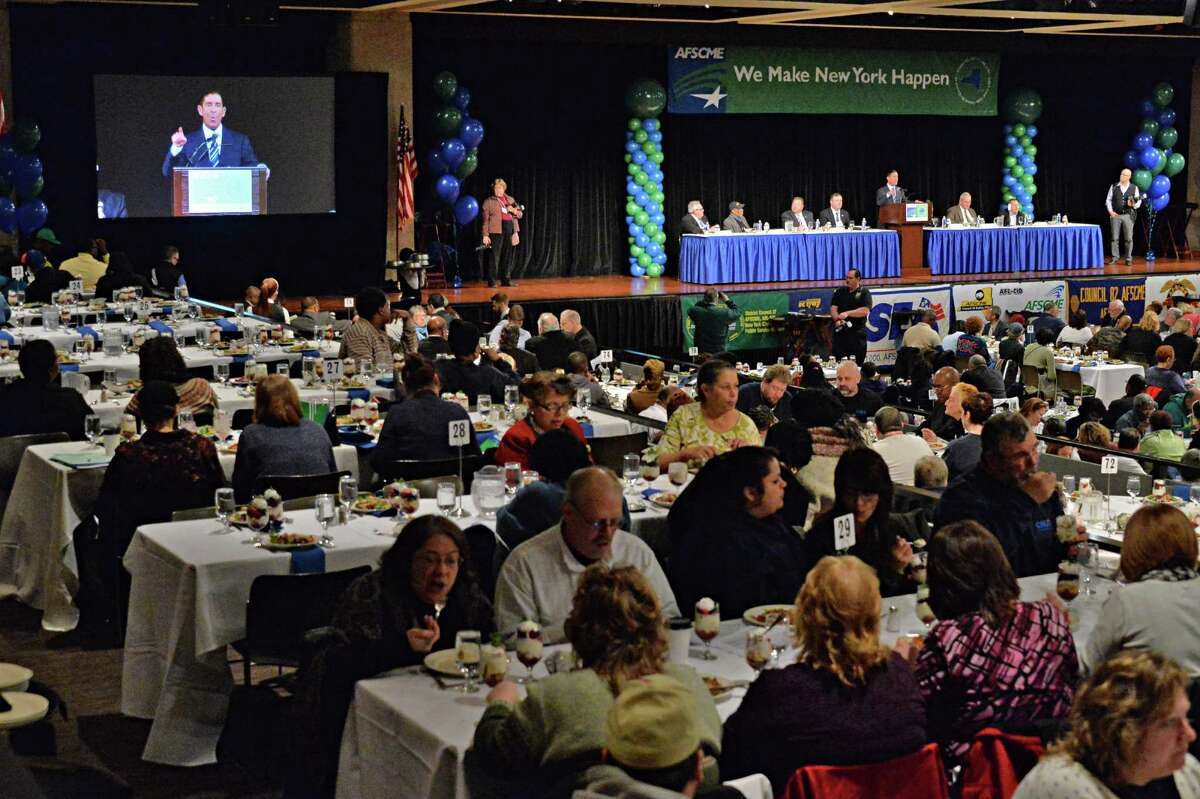 Senate IDC Leader Jeff Klein, at podium and on the big screen, speaks at New York AFSCME's annual Albany Lobby Day lunch at the Capitol on Tuesday, March 4, 2014, in Albany, N.Y. (John Carl D'Annibale / Times Union)