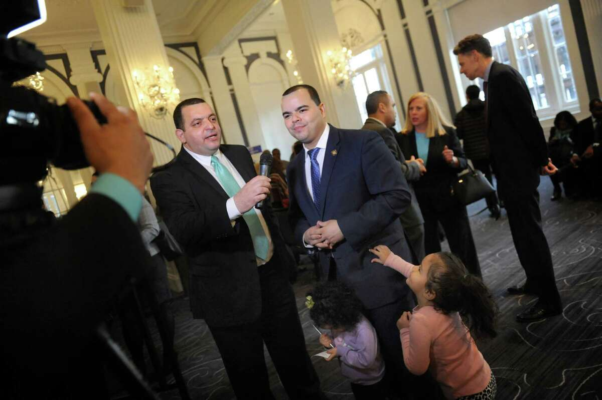 Carlos DeLaVega of the Super Canal network, left, interviews Assemblyman Marcos Crespo, chair of the Puerto Rican and Hispanic Task Force, center, during the opening reception for the 2016 Somos el Futuro conference on Friday, March 18, 2016, at the Renaissance Hotel in Albany, N.Y. Joining Crespo are his daughters Graciela Crespo, 2, and Raquel Crespo, 3. (Cindy Schultz / Times Union)