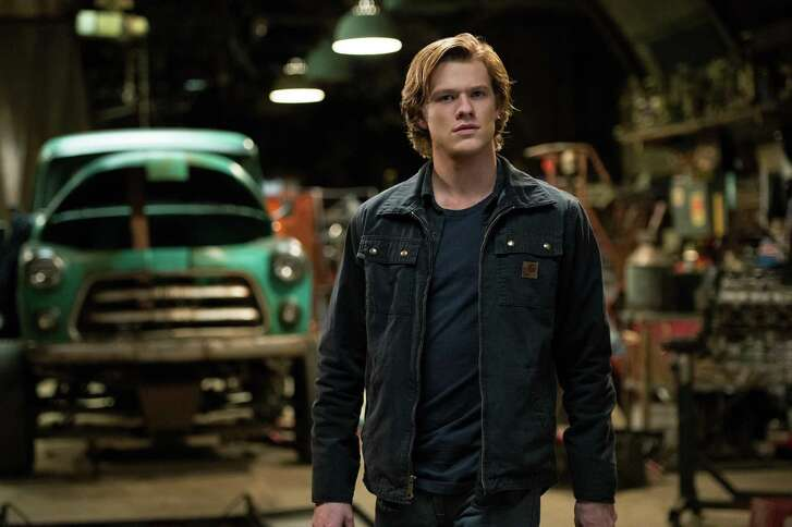 "Tripp (Lucas Till) and his vehicle get a surprise visitor in ""Monster Trucks.""   Credit: Paramount Pictures"