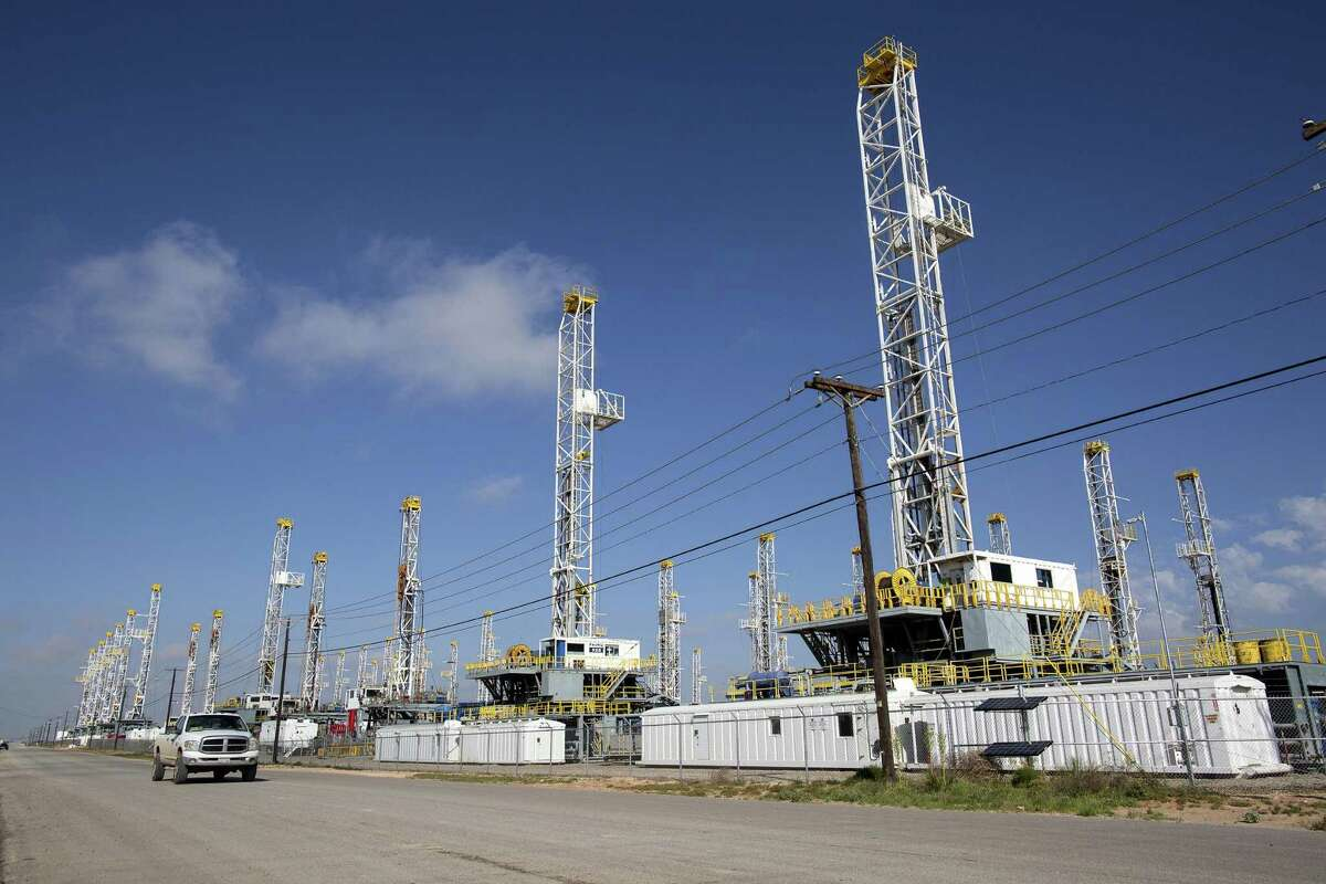 Rigs stand idle in May 2015 in a Helmerich & Payne yard in Odessa. Many workers have left for other industries.