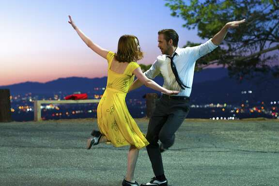 """This image released by Lionsgate shows Ryan Gosling, right, and Emma Stone in a scene from, """"La La Land."""" The Producers Guild of America has nominated awards season favorites �La La Land,� �Moonlight� and �Manchester by the Sea� for its top award, as well as the R-rated superhero film �Deadpool.� Winners will be announced in a Jan. 28 ceremony in Beverly Hills, Calif.  (Dale Robinette/Lionsgate via AP)"""