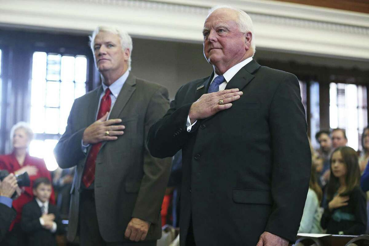 Representative Lyle Larson and Agriculture Commissioner Sid Miller stand at attention during anthems as the 85th Texas Legislative session opens in Austin on January, 10, 2017.