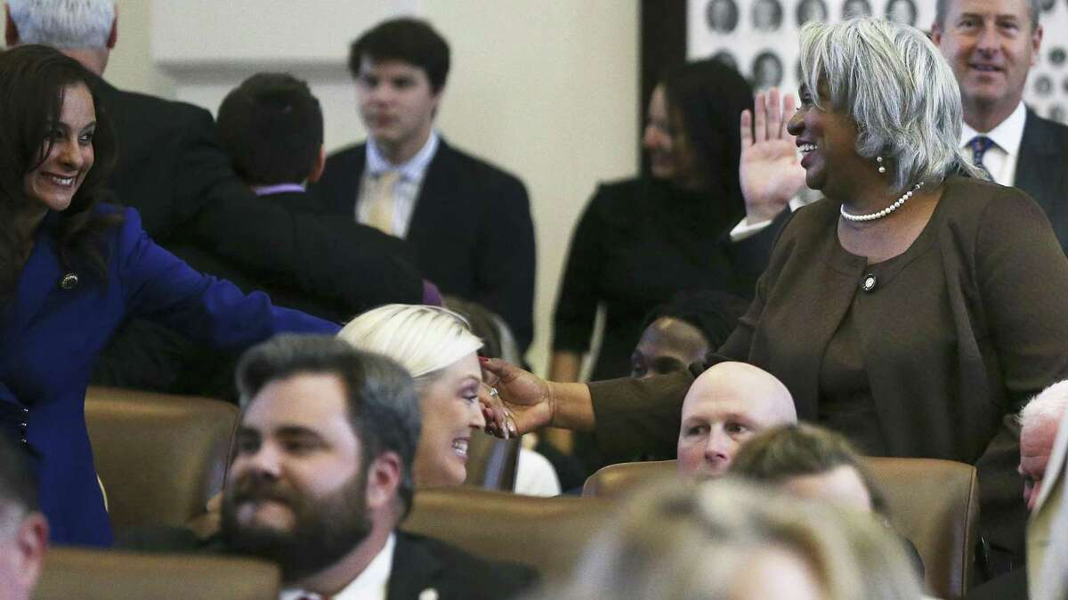 State Rep. Barbara Gervin-Hawkins (right) is congratulated after taking the oath of office as the 85th Texas Legislative session opens in Austin in January. Gervin-Hawkins is sponsoring a bill that could increase the number of attorneys available to defend indigents in death penalty cases.