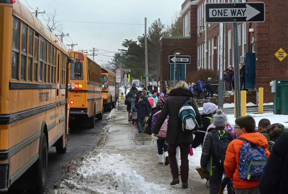 Students and staff from Columbus Magnet School return to the school after being evacuated to Side By Side School following a gas leak on Tuesday afternoon. The school reopened shortly after. Photo: Erik Trautmann / Hearst Connecticut Media / Norwalk Hour