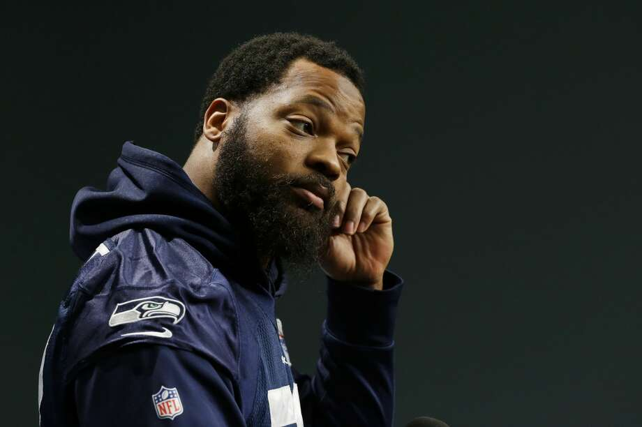Seattle Seahawks defensive end Michael Bennett listens to a question as he talks to reporters, Tuesday, Jan. 10, 2017, in Renton, Wash. The Seahawks will play the Atlanta Falcons in an NFL football NFC playoff game, Saturday, Jan. 14, 2017 in Atlanta (AP Photo/Ted S. Warren) Photo: Ted S. Warren/AP