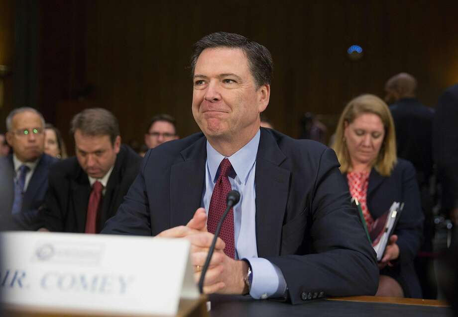FBI Director James Comey testifies testifies during a Senate Armed Services Committe hearing on Russian Intelligence Activities on Capitol Hill in Washington, DC January 10, 2017.  / AFP PHOTO / Tasos KatopodisTASOS KATOPODIS/AFP/Getty Images Photo: TASOS KATOPODIS, AFP/Getty Images