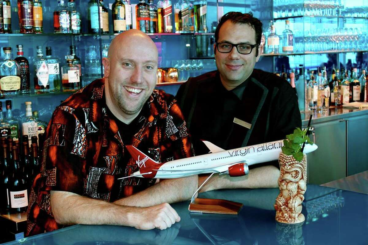 Smuggler's Cove is flying into SFO this year, meaning you'll never be lacking rum on a long layover. Above, Smuggler's Cove owner Martin Cate (left)  and SFO Clubhouse Head Bartender Justin Rhoads celebrate their partnership.