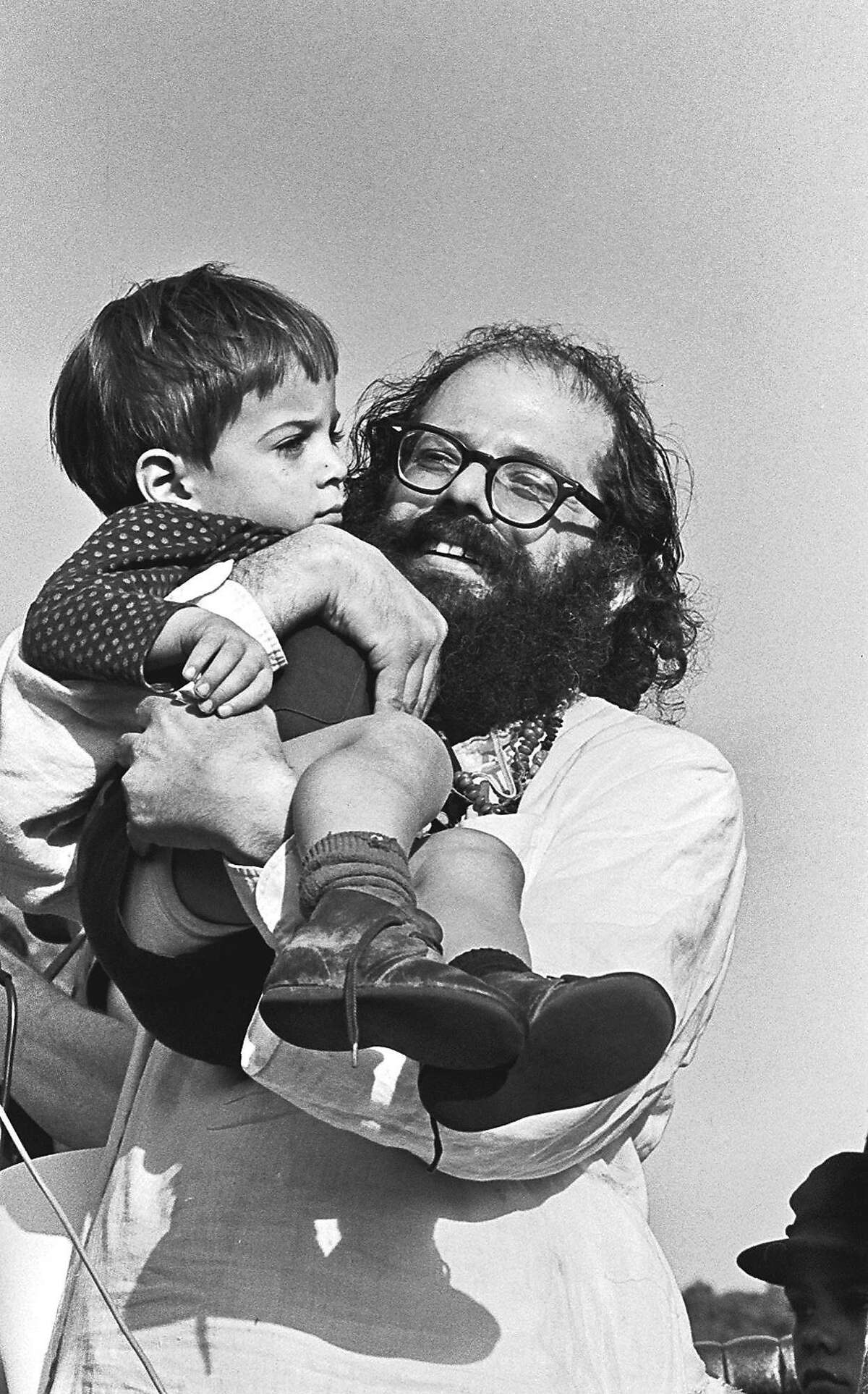 ** ADVANCE FOR SUNDAY, JAN 14, 2007 ** FILE ** Allen Ginsberg is shown holding an unidentified child in San Francisco, Sunday, Jan. 15, 1967. Ginsberg was one of many 1960's icons who appeared at the Human Be-in, a counterculture event that unofficially launched San Francisco's summer of love. In many ways, the '60s as we now know them began on Jan. 14, 1967. And while the decade may have a new meaning for a generation contemplating retirement, those who were in Golden Gate Park that day agreed that neither they nor San Francisco have been the same since. (AP Photo/Steve Rees) ** NO SALES MAGS OUT ONLINE OUT NO TV ** Ran on: 01-14-2007 Allen Ginsberg holds a child at the Human Be-In in 1967. Ran on: 01-14-2007 Allen Ginsberg holds a child at the Human Be-In in 1967. Ran on: 01-05-2010 Poet Allen Ginsberg complained after the Human Be-In about news reports claiming the hippies had gone wild. 150 anniversary maybe