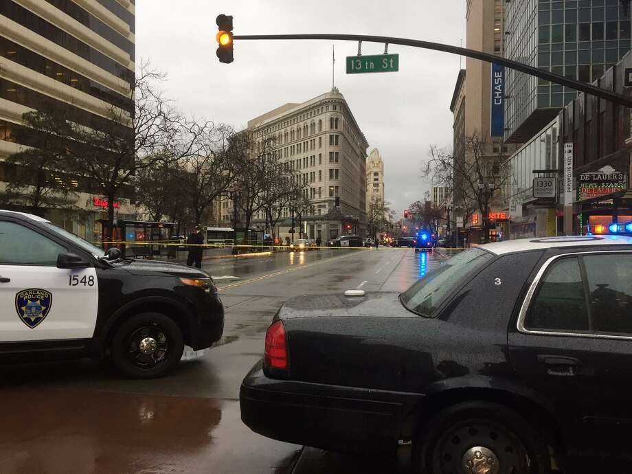 Oakland police officers cordoned off Broadway near 13th Street in downtown after a man was shot. Photo: Jill Tucker