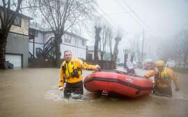 Russian River fire crews head into floodwaters looking for people in distress in Guerneville, Calif. Tuesday, January 10, 2017. Major winter storms drenched much of the bay area leaving some of it flooded.