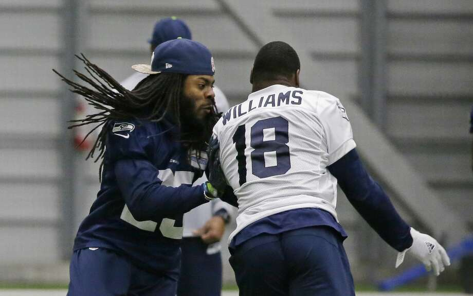 Seattle Seahawks cornerback Richard Sherman, left, runs coverage on wide receiver Kasen Williams after practice, Tuesday, Jan. 10, 2017, in Renton, Wash. The Seahawks will play the Atlanta Falcons in an NFL football NFC playoff game, Saturday, Jan. 14, 2017 in Atlanta (AP Photo/Ted S. Warren) Photo: Ted S. Warren/AP