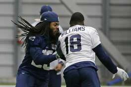 Seattle Seahawks cornerback Richard Sherman, left, runs coverage on wide receiver Kasen Williams after practice, Tuesday, Jan. 10, 2017, in Renton, Wash. The Seahawks will play the Atlanta Falcons in an NFL football NFC playoff game, Saturday, Jan. 14, 2017 in Atlanta (AP Photo/Ted S. Warren)