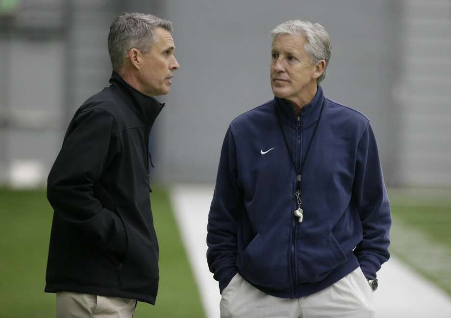 Seattle Seahawks head coach Pete Carroll, right, talks with Washington head coach Chris Petersen, left, following Seahawks practice, Tuesday, Jan. 10, 2017, in Renton, Wash. The Seahawks will play the Atlanta Falcons in an NFL football NFC playoff game, Saturday, Jan. 14, 2017 in Atlanta (AP Photo/Ted S. Warren) Photo: Ted S. Warren/AP