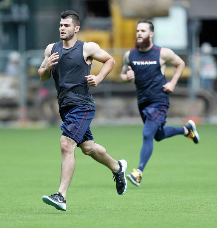 Pitchers Dallas Keuchel and Lance McCullers run as several of the Houston Astros worked out together at Minute Maid Park, Tuesday, January 10, 2017.    ( Karen Warren / Houston Chronicle )
