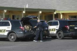 Police carry out evidence in bags as they investigate the scene of a homicide at the Camino Vista Motel at 409 West Highway 90 on January 1, 2017. SAPD report that an officer noticed a suspicious person in the parking lot, and upon questioning the person led them to the room where a body was found. No suspects were arrested.