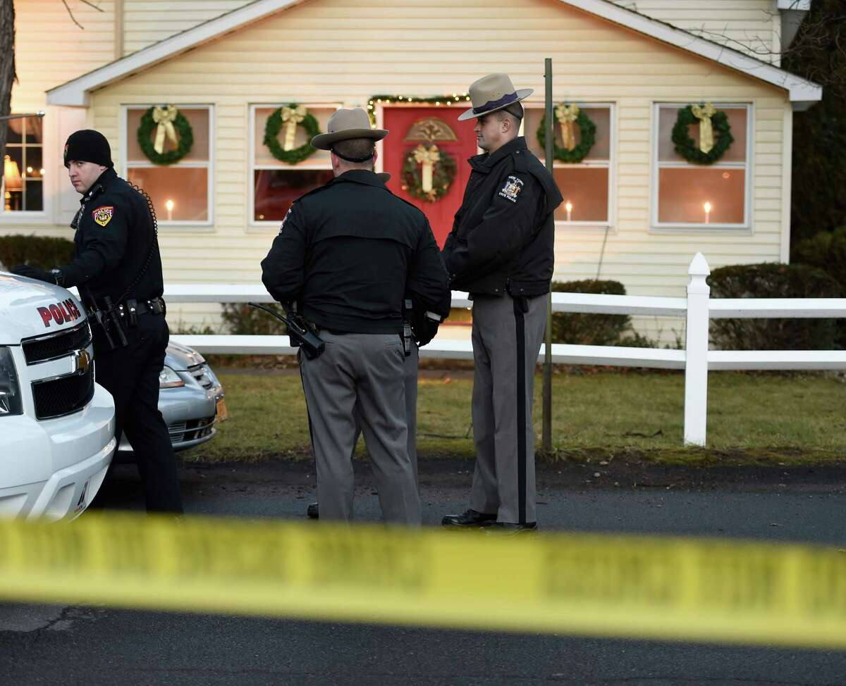 New York State Police and North Greenbush Police Department members investigate a homicide on Powell Street where Bill Chamberlain, the Troy director of operations, died in a Thursday night stabbing near his home Friday morning, Dec. 18, 2015, in Wynantskill, N.Y. (Skip Dickstein/Times Union)