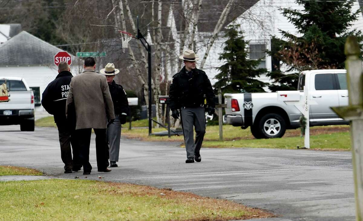 New York State Police and North Greenbush Police Department members investigate a homicide where Bill Chamberlain, the Troy director of operations, died in a Thursday night stabbing near his home Friday morning, Dec. 18, 2015, in Wynantskill, N.Y. (Skip Dickstein/Times Union)