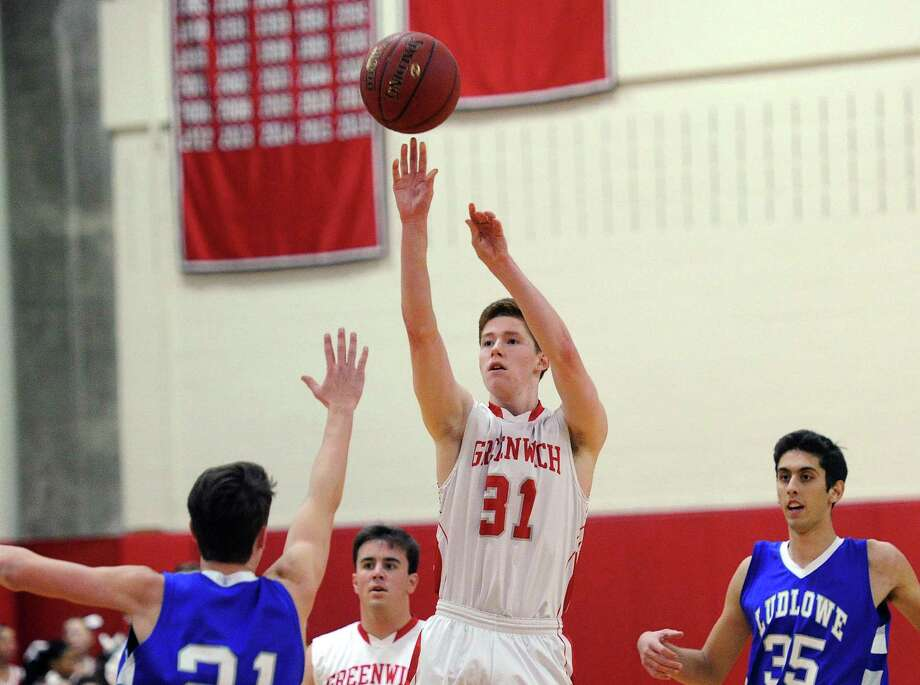 Conor Harkins (31) of Greenwich drains a three-pointer over Fairfield Ludlowe's Ty Stapleton (21) during Tuesday night's game in Greenwich. Photo: Bob Luckey Jr. / Hearst Connecticut Media / Greenwich Time