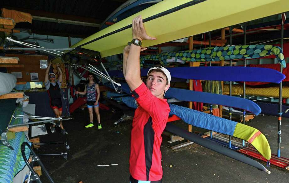 Martime Rowing athlete Brandon Golino gets ready for a morning training on the Norwalk River June 23, 2015, at the rowing facility on Goldstein Place in Norwalk, Conn. Photo: Erik Trautmann / Hearst Connecticut Media / Norwalk Hour