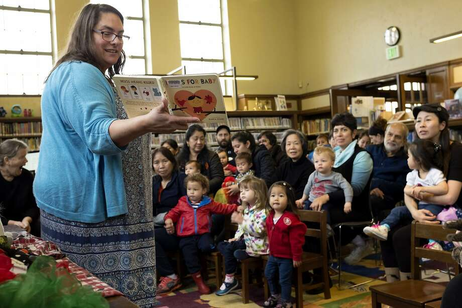 "Children's librarian Meredith Steiner reads ""Besos for Baby: A Little Book of Kisses"" at the West Portal Branch of the San Francisco Public Library on Tuesday, Jan. 10, 2017 in San Francisco, Calif. Through the new program ""We Love Diverse Books,"" the library is attempting to combat a lack of diversity in publishing by advocating for diverse literature. Photo: Santiago Mejia, The Chronicle"