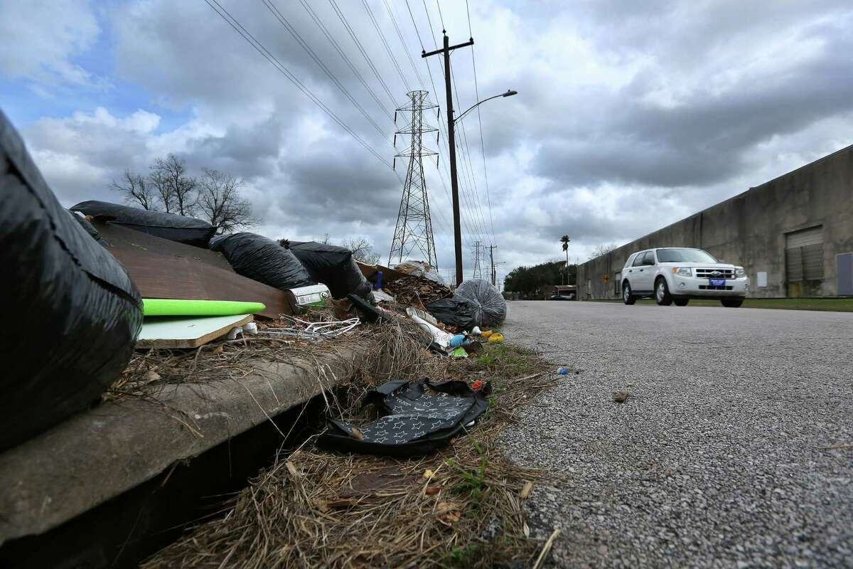 Dumped garbage fills a ditch in the Independence Heights area. A plan would clear such debris.