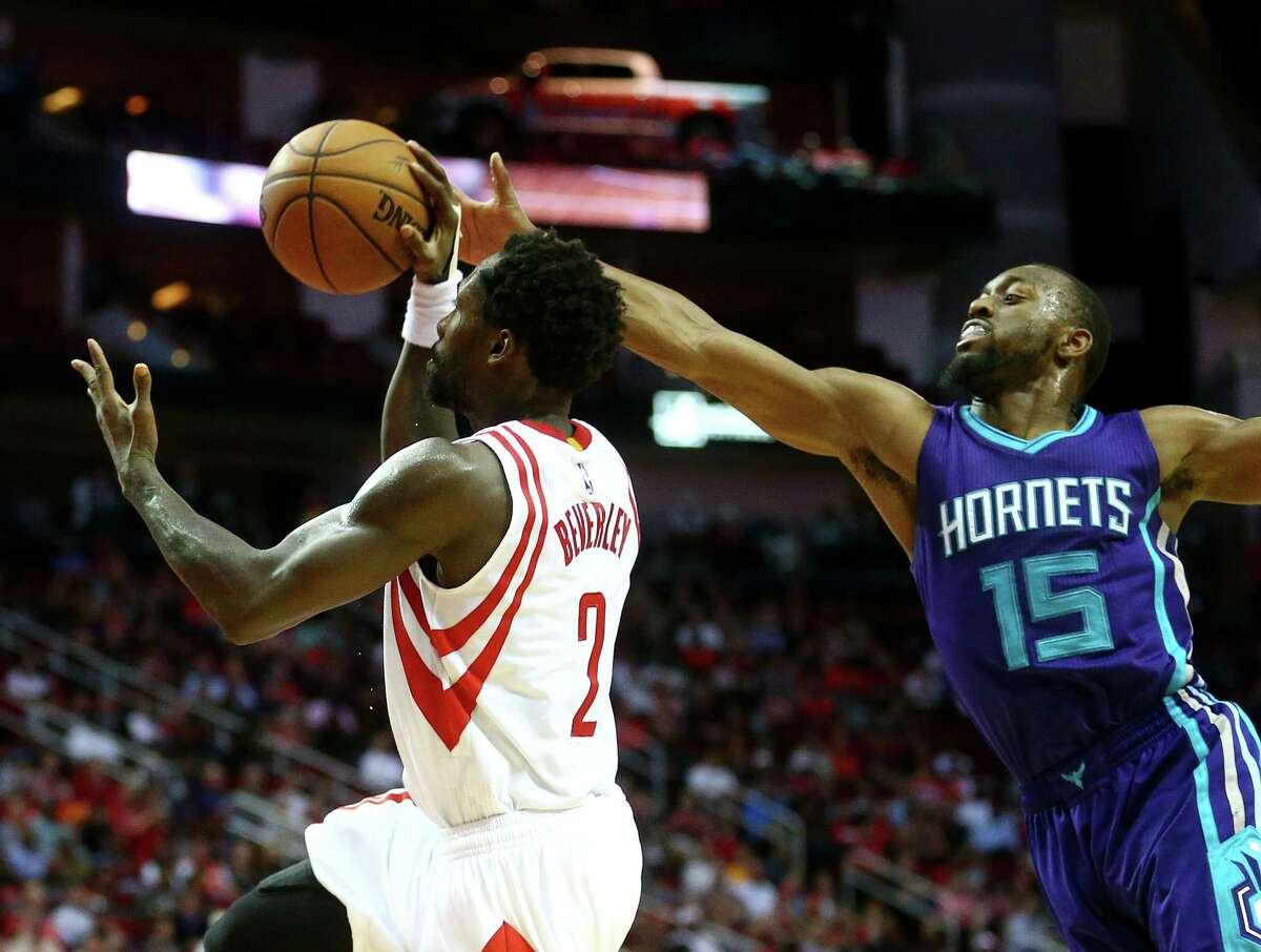 Houston Rockets guard Patrick Beverley (2) is fouled by Charlotte Hornets guard Kemba Walker (15) during the second quarter of an NBA game at the Toyota Center, Tuesday, Jan. 10, 2017, in Houston.