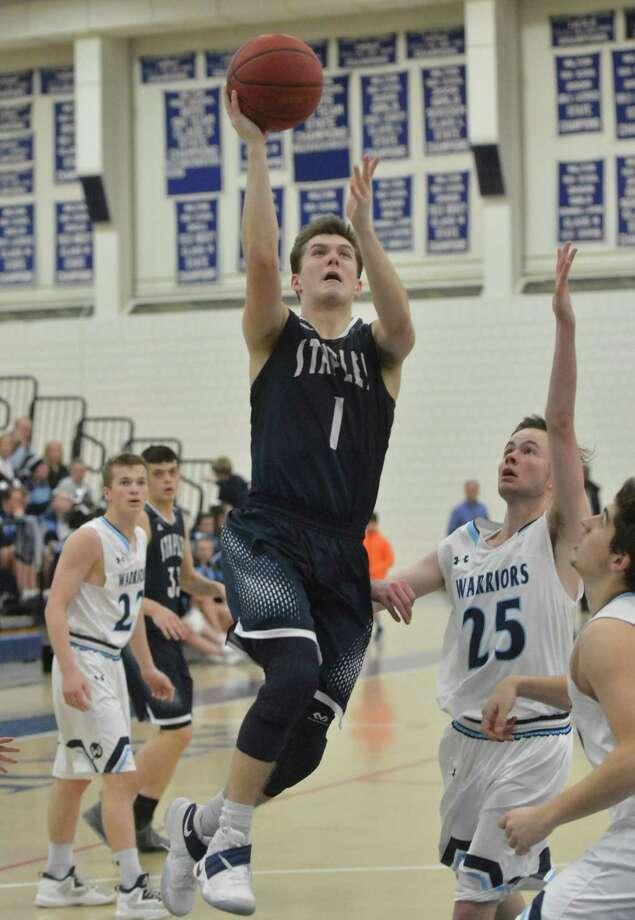 Staples' Justin Seideman shoots and scores against Wilton on Tuesday. Photo: Alex Von Kleydorff / Hearst Connecticut Media / Connecticut Post