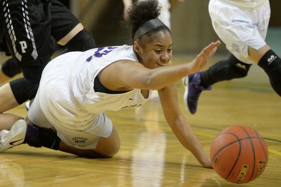 Midland High's Savanna Carter (32) goes after a loose ball during the game against Permian on Tuesday, Jan. 10, 2017, at Chaparral Center.  James Durbin/Reporter-Telegram Photo: James Durbin