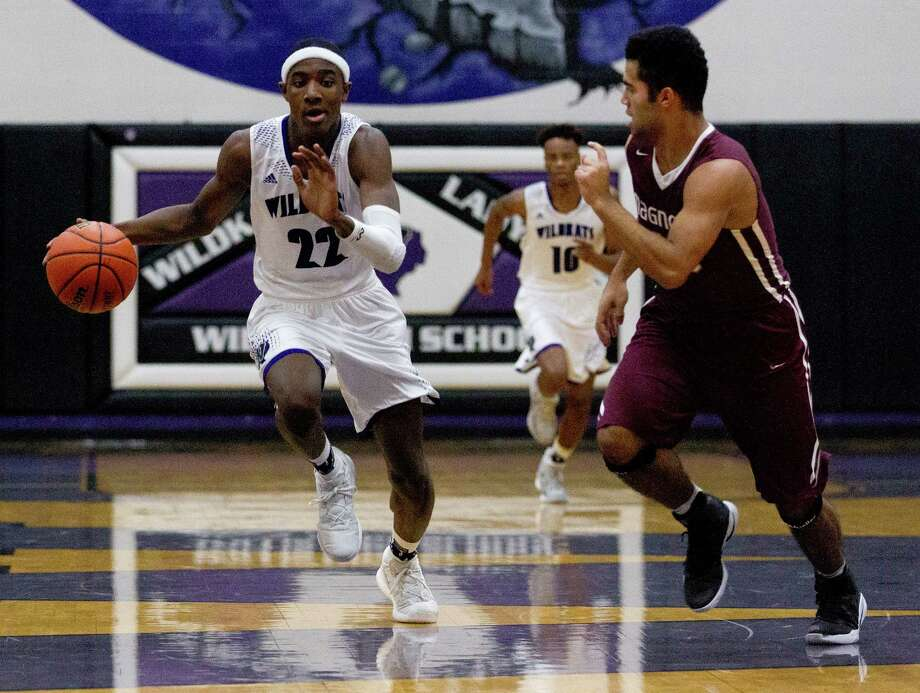 Willis guard Darius Mickens (22) drives the ball past Magnolia guard Eric Larramendi (10) during the first quarter of a District 20-5A high school boys basketball game at Willis High School Tuesday, Jan. 10, 2017, in Willis. Willis defeated Magnolia 73-63. Photo: Jason Fochtman, Staff Photographer / Houston Chronicle