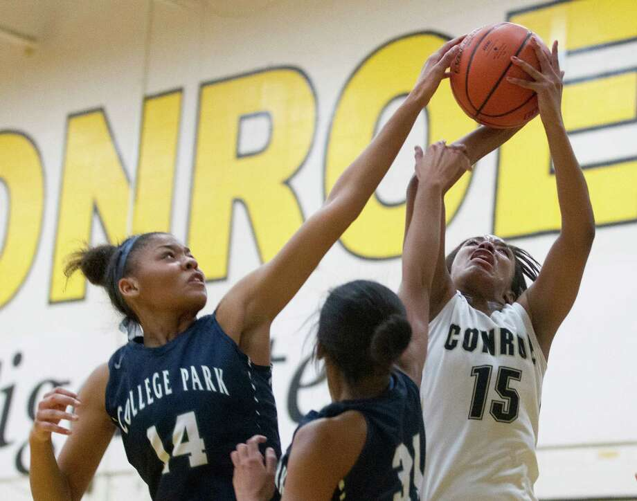 College Park center Sandra Cannady (14) blocks a shot by Conroe center Victoria Ratcliff (15) during the second quarter of a District 16-6A high school girls basketball game at Conroe High School Tuesday, Jan. 10, 2017, in Conroe. College Park defeated Conroe 59-50. Photo: Jason Fochtman, Staff Photographer / Houston Chronicle