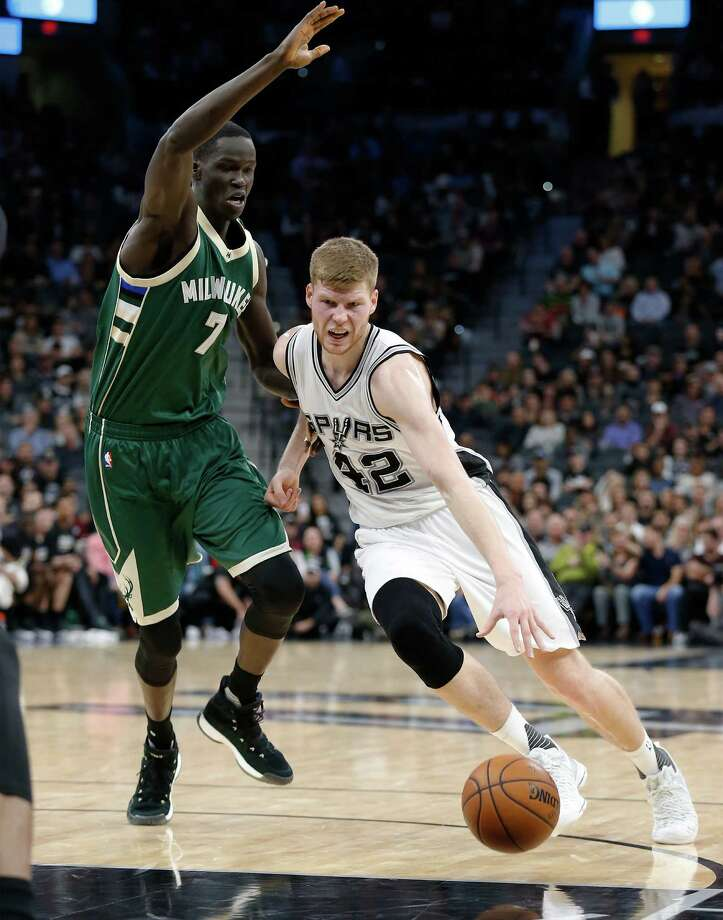 Spurs' Davis Bertans (42) puts the ball on the floor against Milwaukee Bucks' Thon Maker (07) at the AT&T Center on Tuesday, Jan. 10, 2017. Photo: Kin Man Hui, San Antonio Express-News / ©2017 San Antonio Express-News