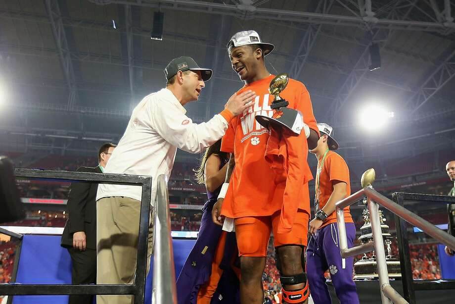 Clemson head coach Dabo Swinney and quarterback Deshaun Watson GLENDALE, AZ - DECEMBER 31: Deshaun Watson #4 of the Clemson Tigers celebrates with head coach Dabo Swinney after winning the Fiesta Bowl offensive MVP trophy after the Clemson Tigers beat the Ohio State Buckeyes 31-0 to win the 2016 PlayStation Fiesta Bowl at University of Phoenix Stadium on December 31, 2016 in Glendale, Arizona. (Photo by Christian Petersen/Getty Images) Photo: Christian Petersen, Getty Images