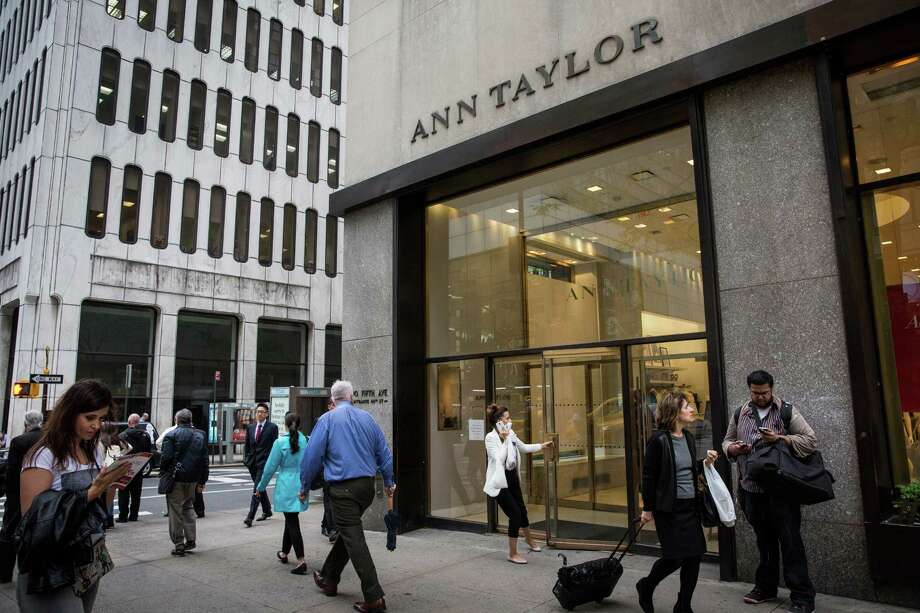 NEW YORK, NY - MAY 18:  People pass the window display of an Ann Taylor women's clothing store in Manhattan on May 18, 2015 in New York City. Ascena  Retail Group which owns Lane Bryant and Dressbarn, announced it is purchasing Ann Taylor and Loft retail stores for $2.16 billion to expand its women's apparel business.  (Photo by Andrew Burton/Getty Images) ORG XMIT: 554940623 Photo: Andrew Burton / 2015 Getty Images