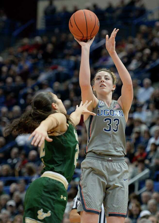 Connecticut's Katie Lou Samuelson shoots over South Florida's Laia Flores, left, in the first half of an NCAA college basketball game, Tuesday, Jan. 10, 2017, in Hartford, Conn. (AP Photo/Jessica Hill) ORG XMIT: CTJH104 Photo: Jessica Hill / AP2017