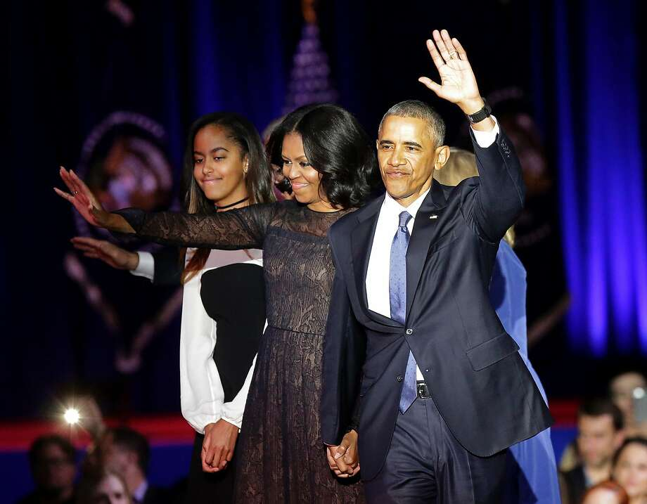US First Lady Michelle Obama (C) and US President Barack Obama greet supporters as daughter Malia looks on after the President delivered his farewell address in Chicago, Illinois on January 10, 2017. Barack Obama closes the book on his presidency, with a farewell speech in Chicago that will try to lift supporters shaken by Donald Trump's shock election. / AFP PHOTO / Joshua LOTTJOSHUA LOTT/AFP/Getty Images Photo: JOSHUA LOTT, AFP/Getty Images