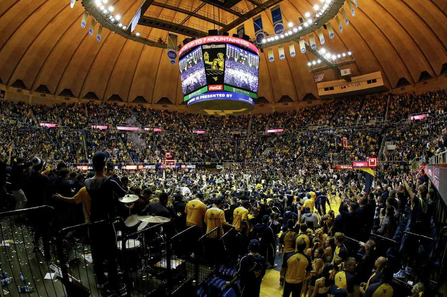 MORGANTOWN, WV - JANUARY 10:  WVU students storm the court after upsetting Baylor 89-68 at the WVU Coliseum on January 10, 2017 in Morgantown, West Virginia. Photo: Justin K. Aller, Getty Images / 2017 Getty Images